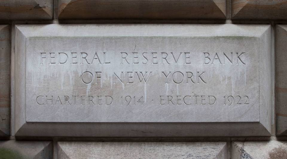 A cornerstone in the Federal Reserve Bank of New York building is seen on July 29, 2011 in New York City.