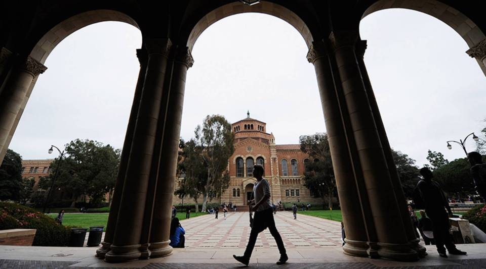 A student walks on the campus of the University of California, Los Angeles.