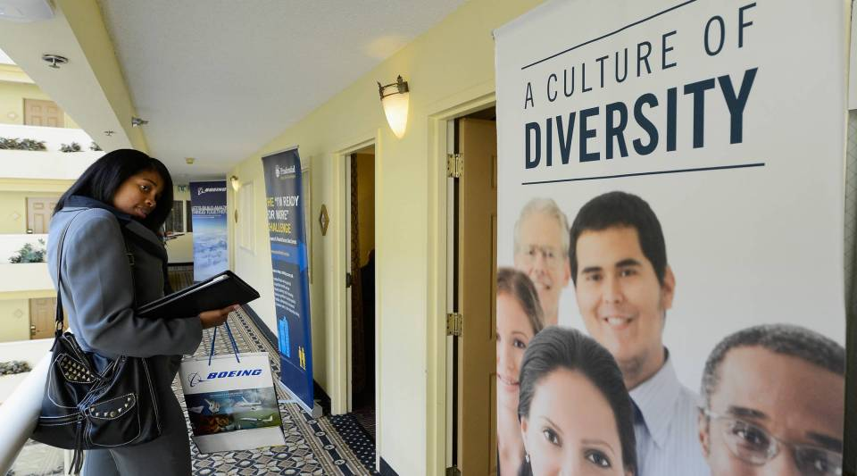 A job seeker waits to speak with a Bank of the West job recruiter during the Professional and Executive Diversity Job Fair in Los Angeles in 2012.