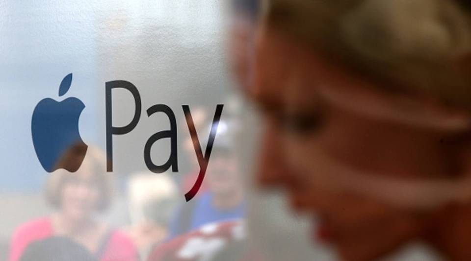 The Apple Pay logo is displayed in a mobile kiosk sponsored by Visa and Wells Fargo to demonstrate the new Apple Pay mobile payment system on October 20, 2014 in San Francisco City.