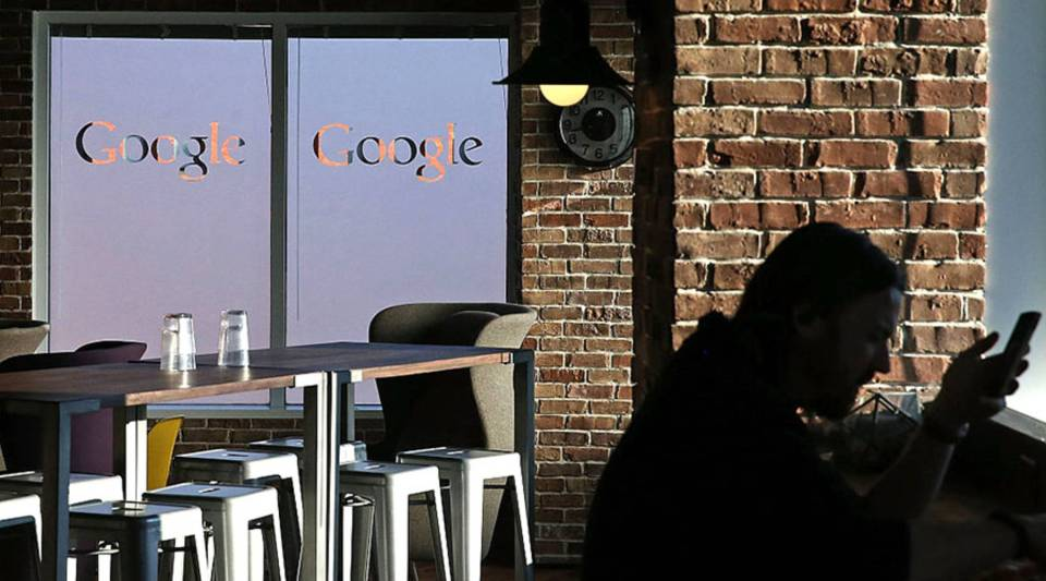 An employee sits in the cafeteria of Google's Washington headquarters, Jan. 8, 2015 in Washington, D.C.