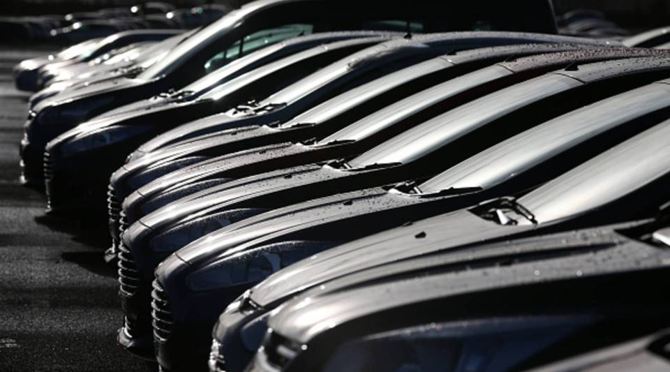 Cars are prepared for distribution at a Ford factory on January 13, 2015.