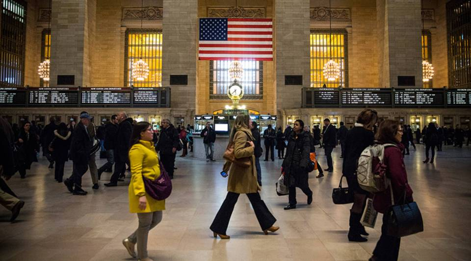 Commuters make their way through Grand Central Terminal during evening rush hour in New York City.