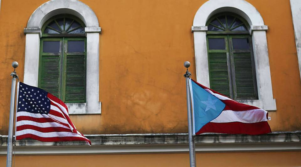 An American flag and Puerto Rican flag fly next to each other in Old San Juan in Puerto Rico.