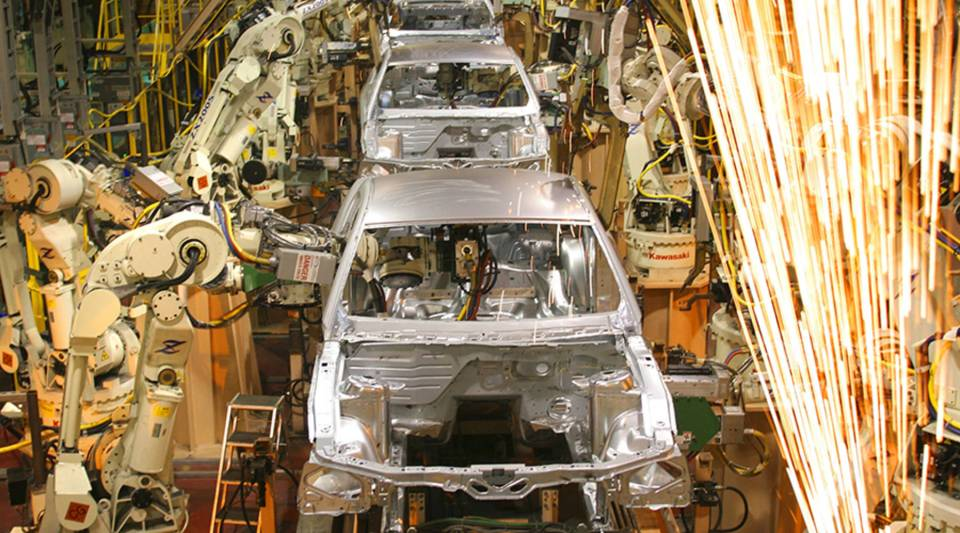 Ford Mustangs are assembled at a plant in Flat Rock, Michigan, in 2004.