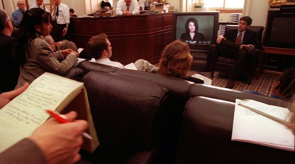 Reporters in a press room in the U.S. Capitol watch as the videotaped testimony of Monica Lewinsky is played in the Senate during the impeachment trial of President Bill Clinton on Feb. 6, 1999.