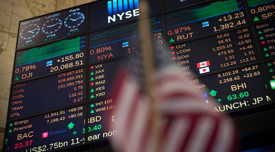 A video board shows the Dow Jones closing above 20,000 for the first time at the New York Stock Exchange January 25, 2017 in New York.