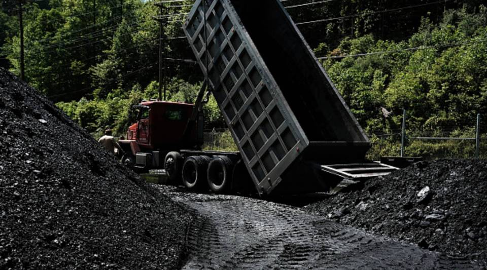 A truck dumps coal at a coal prep plant outside the city of Welch in rural West Virginia on May 19, 2017.