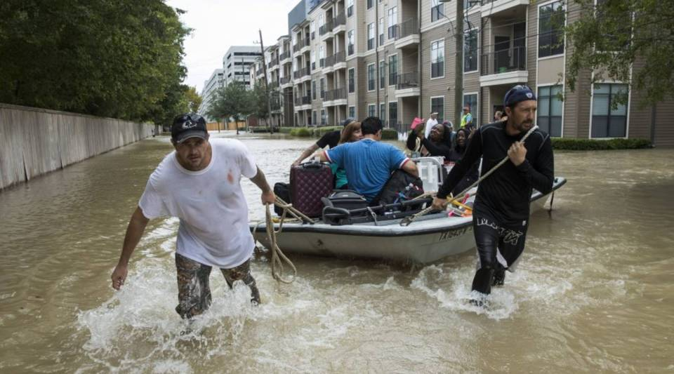 Residents evacuate an apartment complex in west Houston where high water coming from the Addicks Reservoir flooded the area after Hurricane Harvey on Aug. 30, 2017.