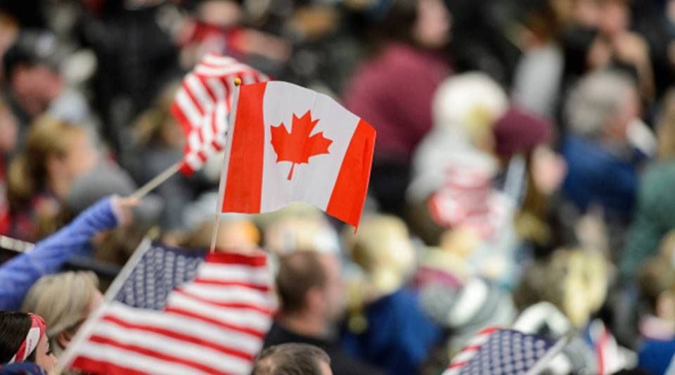 A fan waves a Canada flag during the game between the United States and Canada on Dec. 3, 2017 at Xcel Energy Center in St Paul, Minnesota.