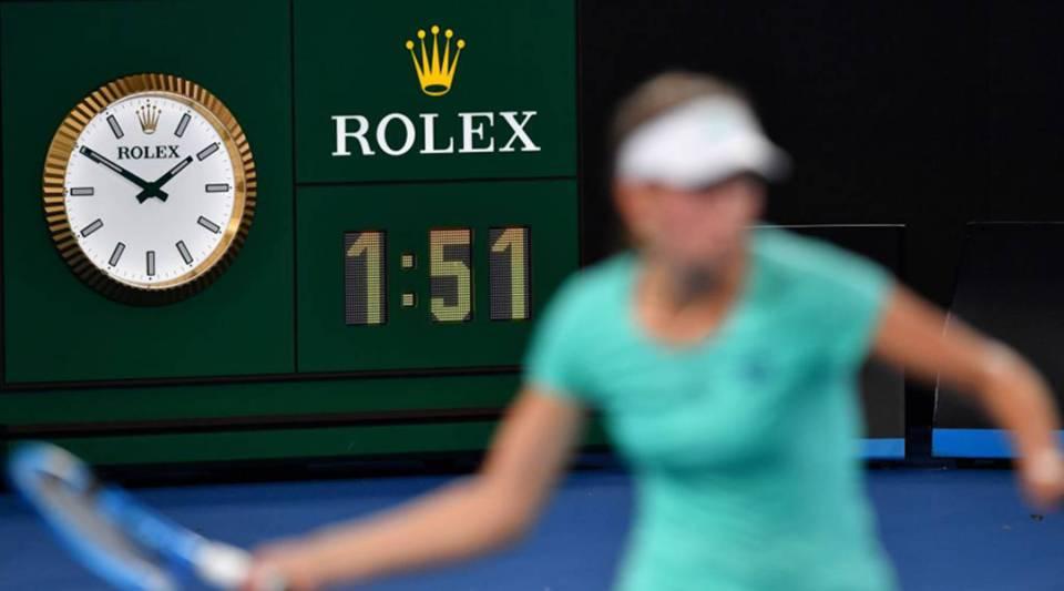 Belgium's Elise Mertens plays a shot beside a clock during a match against Australia's Daria Gavrilova at the Australian Open in Melbourne in January.