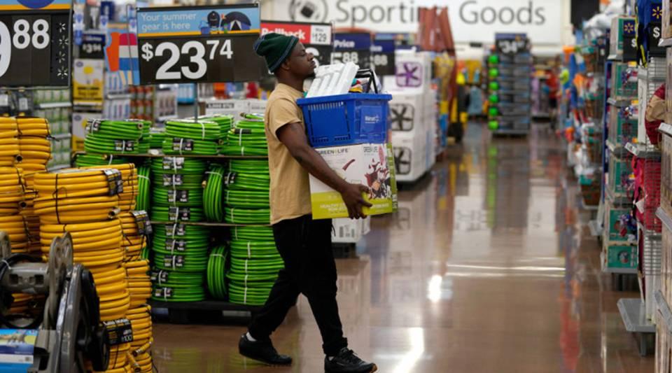 A customer carries merchandise through a Walmart Supercenter.