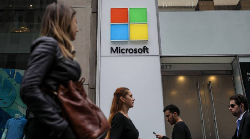 People walk past the Microsoft store on Fifth Avenue in Midtown Manhattan in June in New York City.