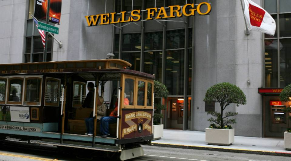 A cable car passes by a Wells Fargo branch. The banking company has a team of historians to research and document the family histories of its top clients.