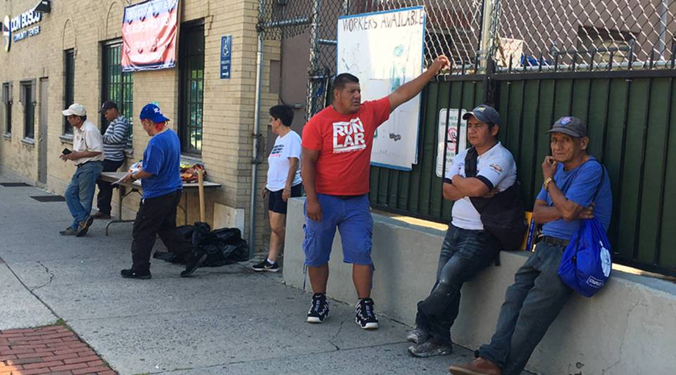 Day laborers wait for offers of work outside the Don Bosco Workers center in Port Chester, New York.