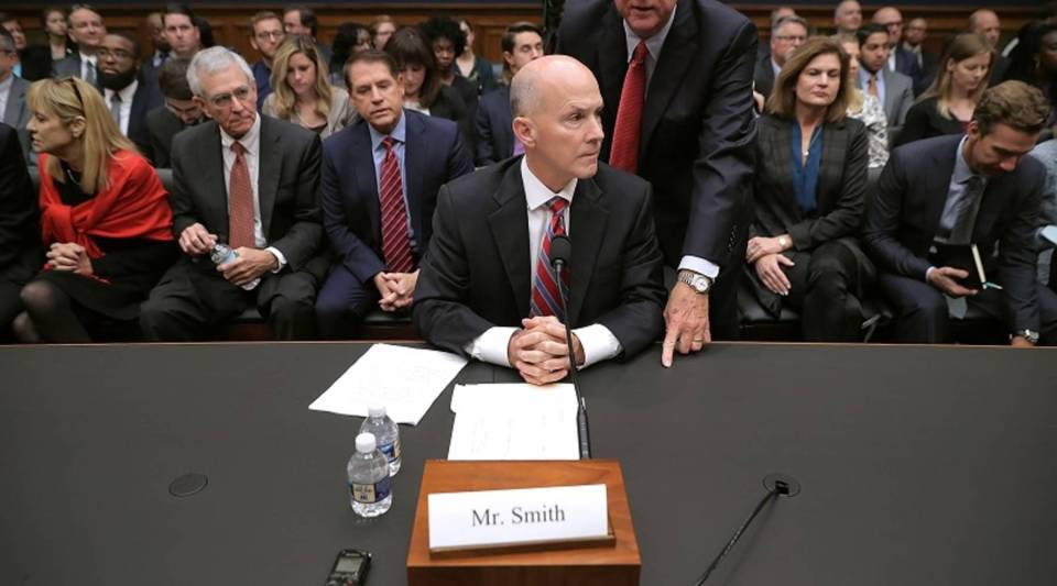 Saxby Chambliss, a former Republican senator from Georgia, advises former Equifax CEO Richard Smith before he testifies to the House Energy and Commerce Committee's Digital Commerce and Consumer Protection Subcommittee on Capitol Hill on Oct. 3, 2017. Smith stepped down as CEO of Equifax after it was reported that hackers broke into the credit reporting agency and made off with the personal information of more than 147 million Americans.