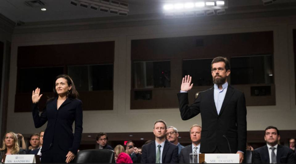 Facebook chief operating officer Sheryl Sandberg and Twitter chief executive officer Jack Dorsey are sworn-in for a Senate Intelligence Committee hearing concerning foreign influence operations' use of social media platforms, on Capitol Hill, Sept. 5, 2018 in Washington, DC.