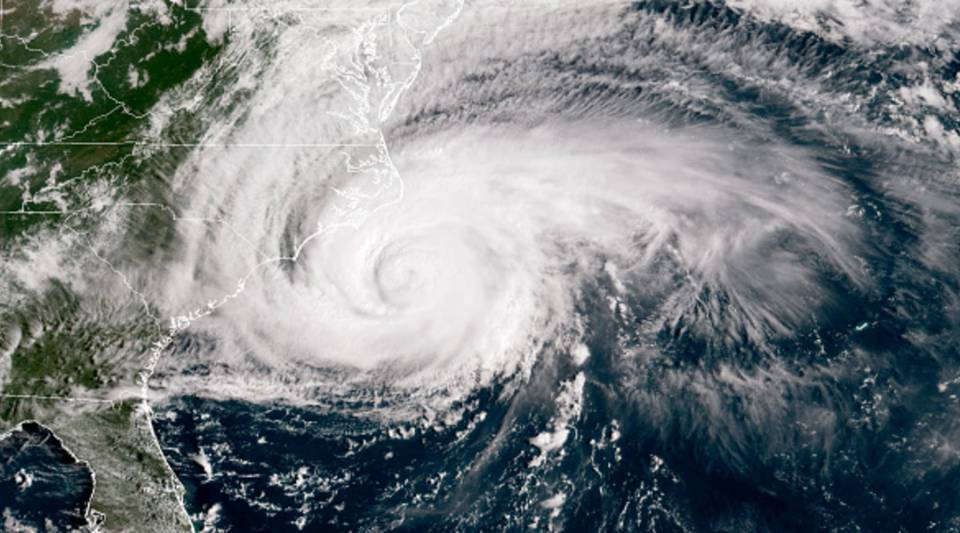 In this NOAA satellite handout image, shows Hurricane Florence it just makes landfall off the coast of the U.S. in the Atlantic Ocean on Sept.13, 2018.