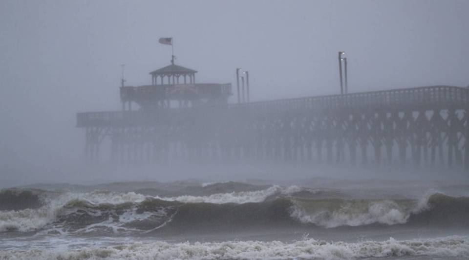 Waves created by Hurricane Florence are seen along Cherry Grove Fishing Pier on September 14, 2018 in North Myrtle Beach, United States.