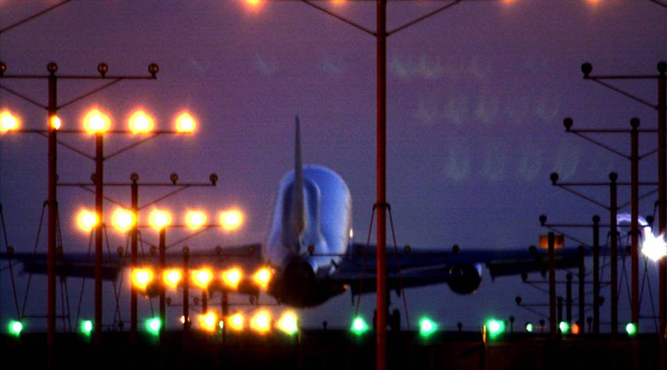 A jet makes an evening landing June 21, 2001 at Los Angeles International Airport.