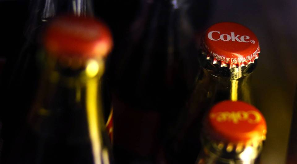 Bottles of Coca Cola sit in a cooler at a market on April 16, 2013 in San Francisco, California.