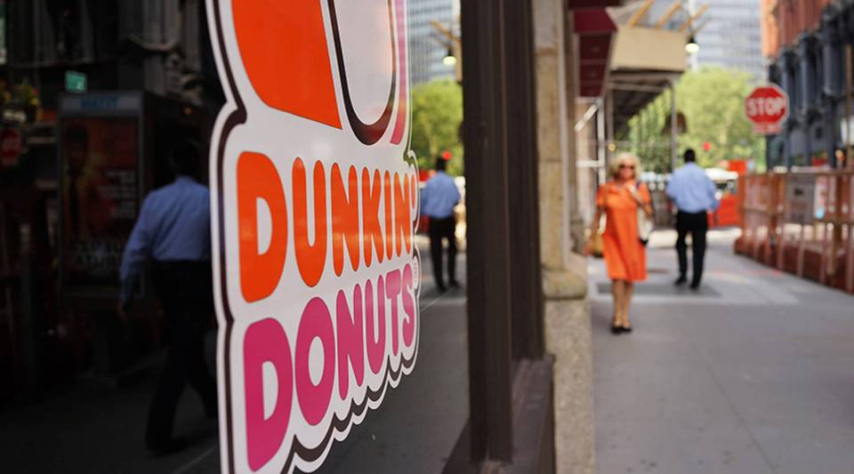 A sign for a Dunkin' Donuts store is viewed on August 26, 2013 in New York City.