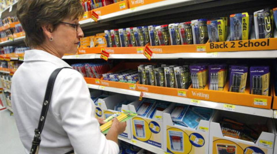 School teacher Judy Lindsey shops for back-to-school items in a Wal-Mart store July 28, 2003 in Rolling Meadows, Illinois.