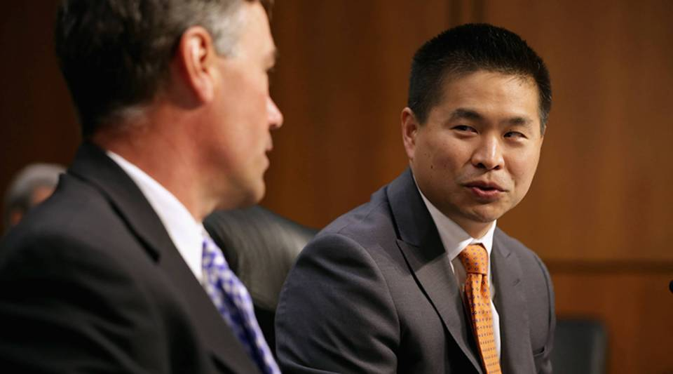IEX Group President and CEO Bradley Katsuyama, right, and Notre Dame finance professor Robert Battalio prepare to testify before the Senate Homeland Security and Governmental Affairs Investigations Subcommittee about high-speed stock trading in 2014.