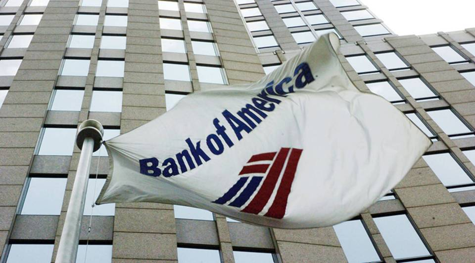 A flag flies outside the Bank of America Corporate Center June 30, 2005 in downtown Charlotte, North Carolina.