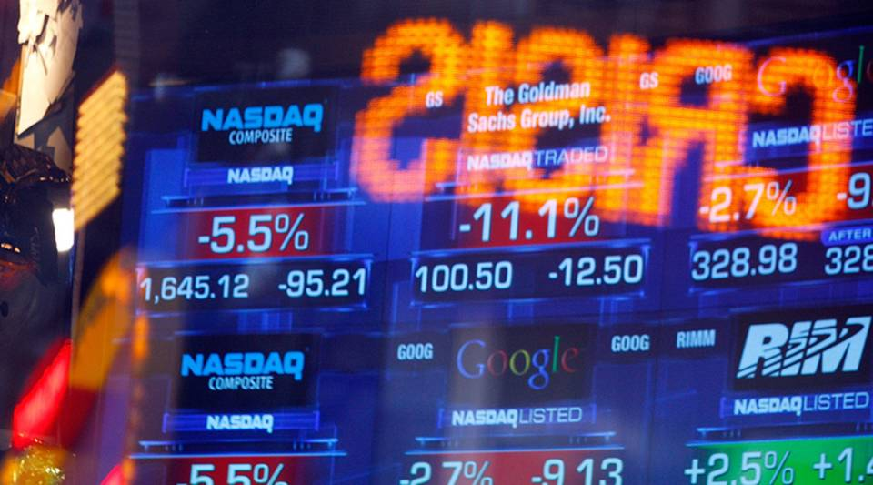 News tickers at the Nasdaq MarketSite show negative numbers October 9, 2008 in New York City.