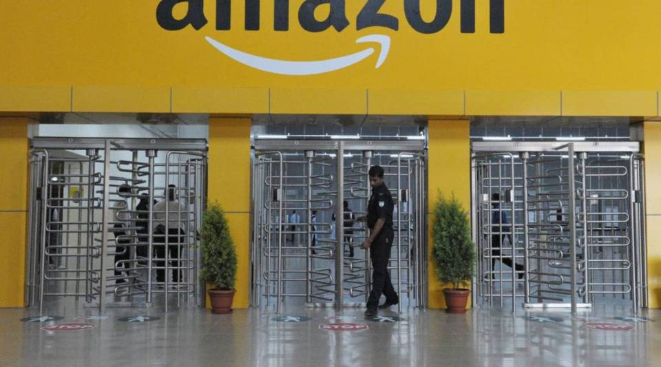 An Indian security guard walks inside Amazon's largest Fulfillment Centre (FC) in India, on the outskirts of Hyderabad on September 7, 2017.