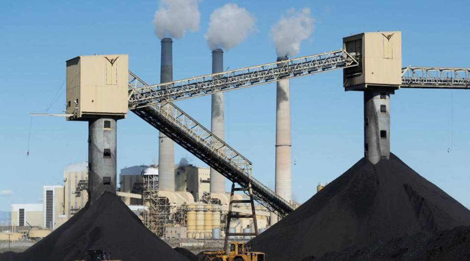 Piles of coal sit in front of PacifiCorp's 1,440-megawatt coal-fired power plant in 2017 in Castle Dale, Utah.
