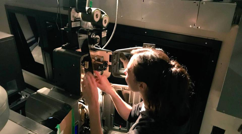 Genevieve Havemeyer-King practices threading a 70 mm projector at the Alamo Drafthouse movie theater in Brooklyn, New York.
