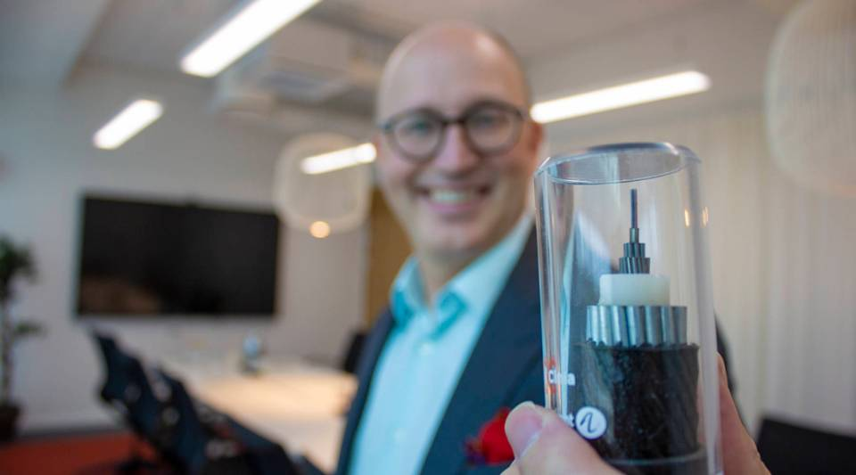Jussi Pekka Joensuu, an adviser for Cinia, holds up a piece of internet sea cable at Cinia's offices in Helsinki. Most global internet communications travel on the 745,000 miles of sea cables buried beneath the ocean floor.
