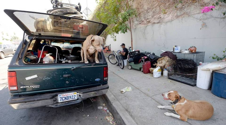 Nearly 15,000 cars are used as homes in Los Angeles County, according to the Los Angeles Homeless Services Authority. Above, a man who lives in his car repairs a bicycle in the city of LA.