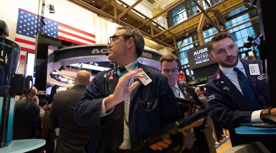 Traders work on the floor at the closing bell of the Dow Industrial Average at the New York Stock Exchange on Wednesday.