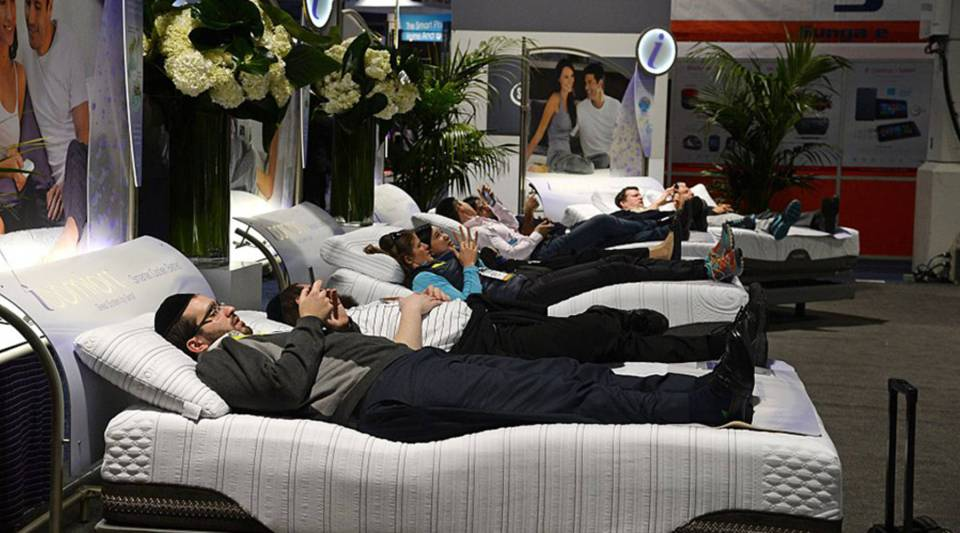 People check out Serta mattresses at the 2015 Consumer Electronics Show in Las Vegas.