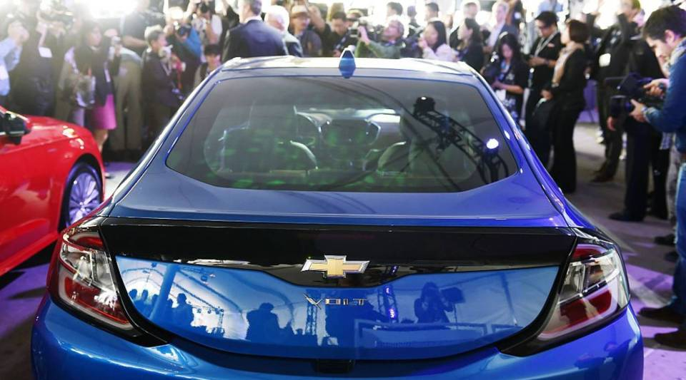 A crowd gathers around a 2016 Chevrolet Volt after it was named 2016 Green Car of the Year, at the 2015 Los Angeles Auto Show in Los Angeles, California, November 19, 2015.