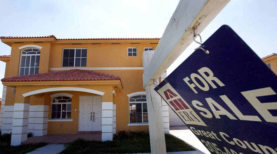 A 'For Sale' sign sits in front of a new home May 27, 2004 in Miami, Florida.