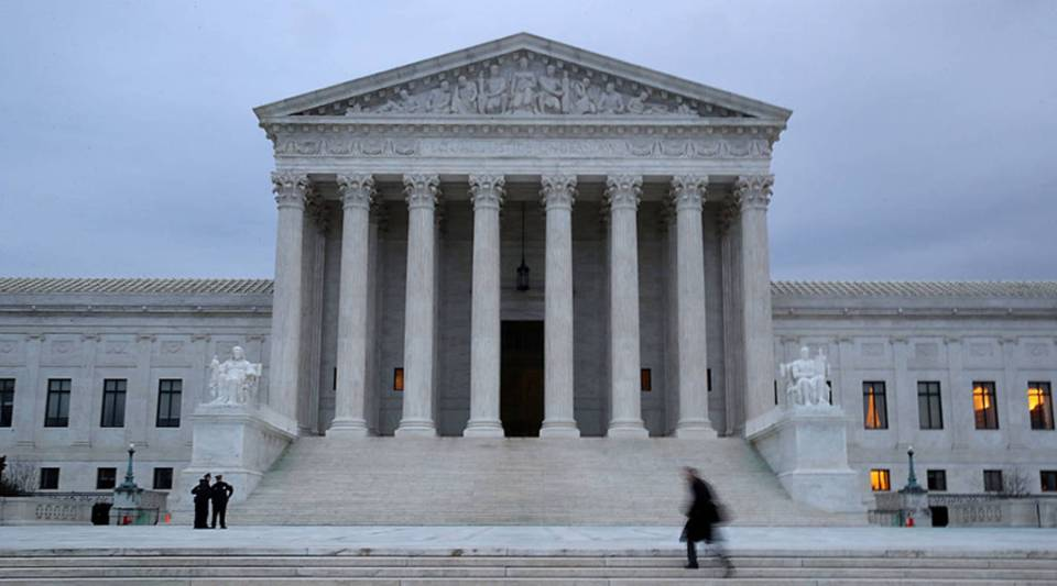 A man walks up the steps of the U.S. Supreme Court in Washington, D.C.