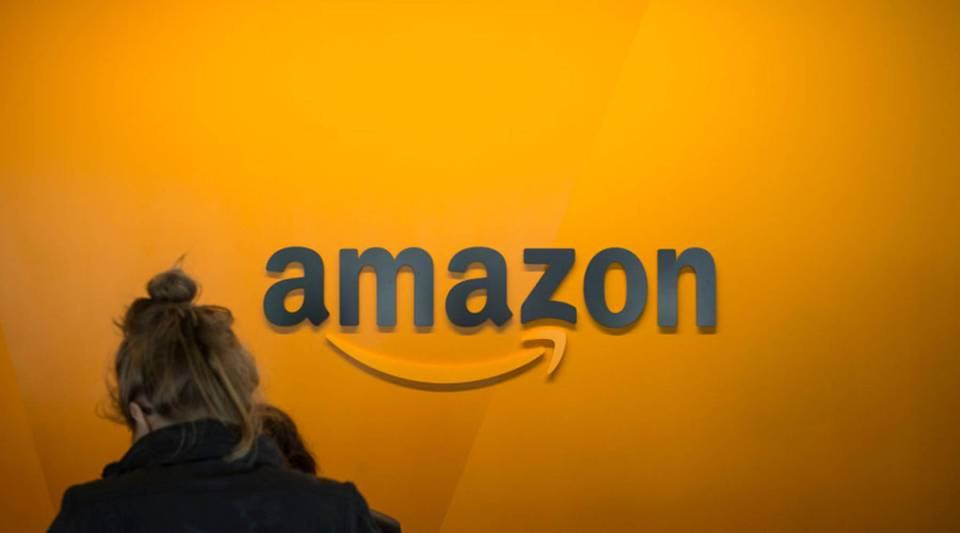 A visitor checks in at the Amazon corporate headquarters in Seattle, Washington. On Oct. 2, 2018, Amazon announced U.S. workers would receive  a minimum of $15 per hour.