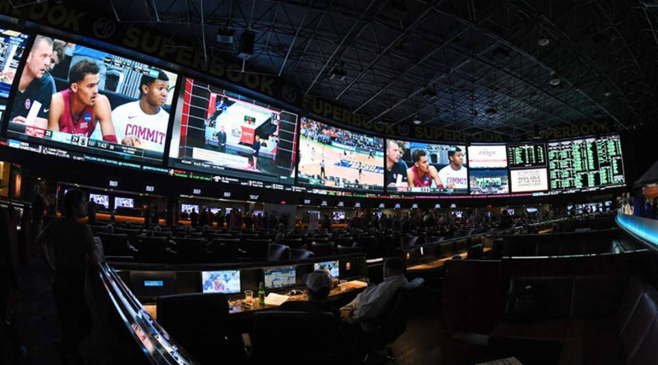 Guests attend a viewing party for the NCAA men's college basketball tournament inside the Race & Sports SuperBook at the Westgate Las Vegas Resort Casino in March.