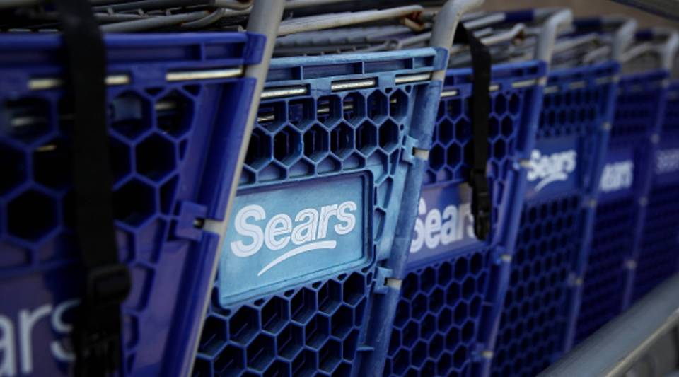 The Sears logo is displayed on shopping carts outside of a Sears store on May 31, 2018 in Richmond, California.