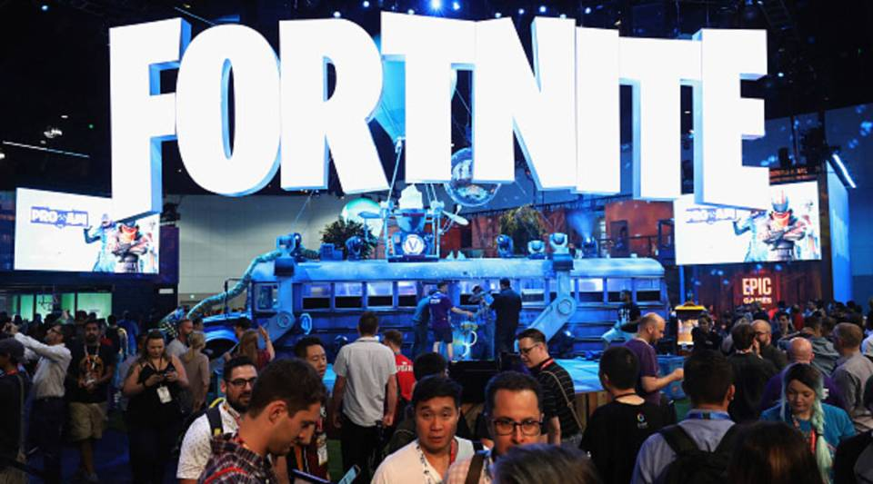 "Game enthusiasts and industry personnel visit the ""Fortnite"" exhibit during the Electronic Entertainment Expo E3 at the Los Angeles Convention Center on June 12, 2018."