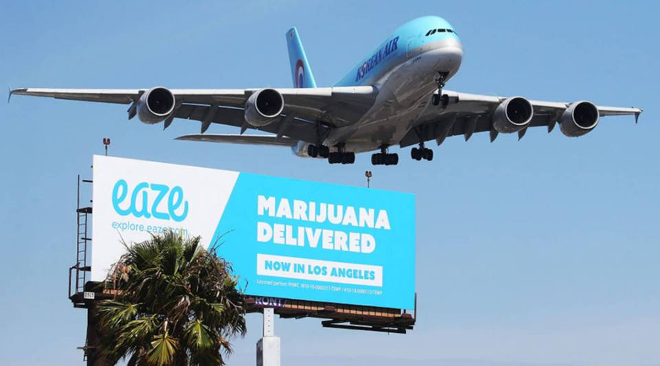 A Los Angeles billboard advertising the marijuana delivery service Eaze.