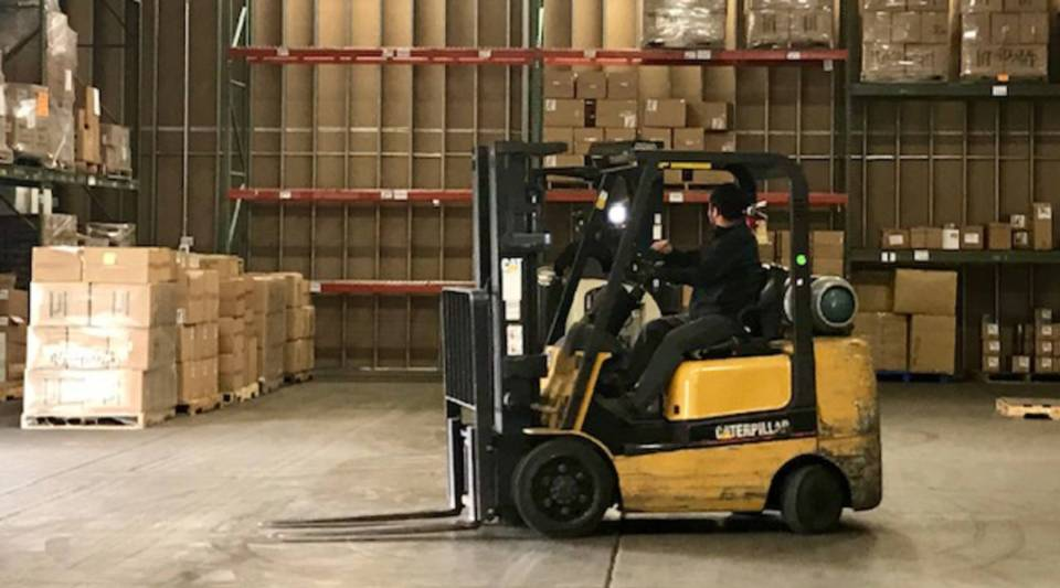 A worker about to move stock at the Medsource Labs warehouse in Chaska, Minnesota.