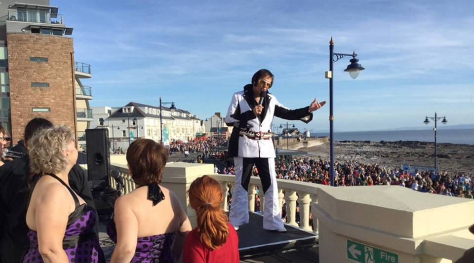 Ordained minister and Elvis Tribute Artist Reverend Wyn Roberts  officiating and performing on the roof of the Porthcawl Grand Pavilion.