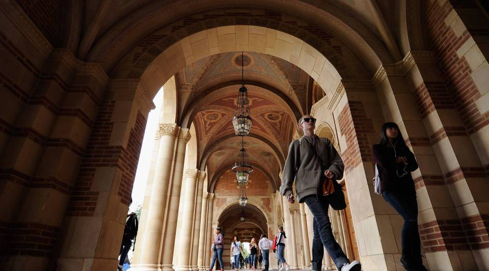 Students walk near Royce Hall on the campus of UCLA on April 23, 2012 in Los Angeles, Calif.