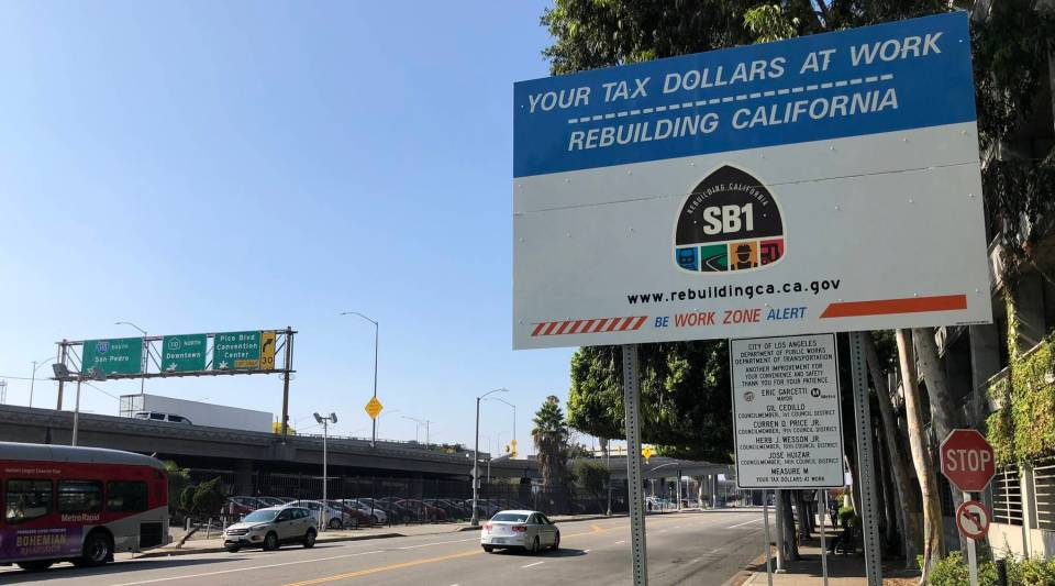 A sign promotes street repairs being funded by California's year-old gas tax.