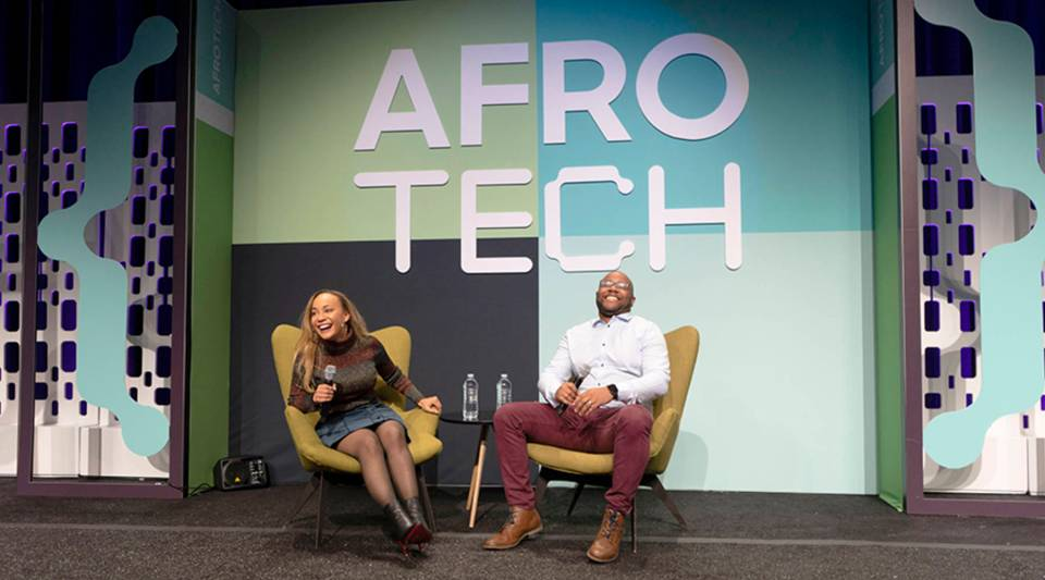 Blavity's Morgan DeBaun and Jeff Nelson on stage at AfroTech 2018.